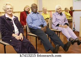 Senior adults in a stretching class