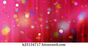confetti against a red blurred curtain background