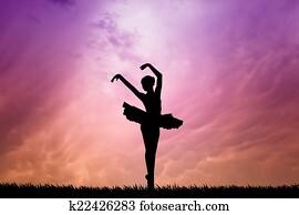 Ballet dancer at sunset