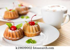 fancy cakes dessert with cappuccino coffee on table