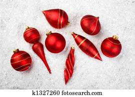 An image of christmas ornaments in snow