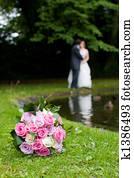 Bride & Groom behind a bouquet