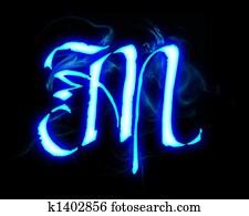 Blue flame magic font over black background. Letter M