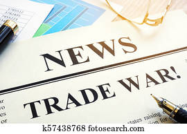 Newspaper with title Trade war on a desk.