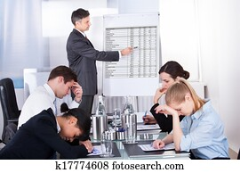Bored Employees In Business Meeting