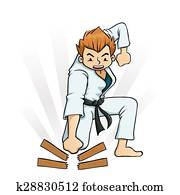 Boy Breaking Board in Karate