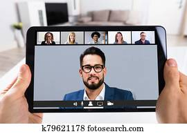 Person Video Conferencing With Doctor On Digital Tablet