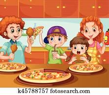 Family having pizza in kitchen