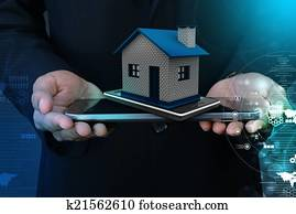 Showing home with smart phone