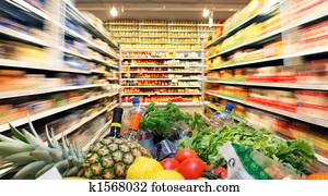 Shopping cart with fruit vegetable food in supermarket