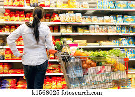 Woman in a supermarket with a large selection