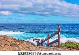 Atlantic Ocean and rocky coast of Tenerife island with footpath to the wate