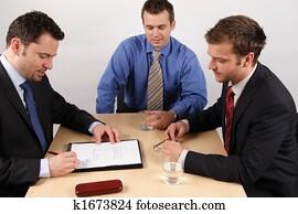 Three businessmen handling negotiations. 1