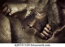Artistic portrait of a poor little boy