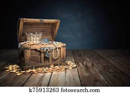 Open treasure chest filled with golden coins, gold and jewelry.