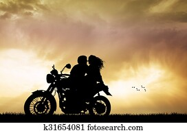 couple kissing on motorbike