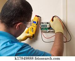 Hispanic handyman repairman conducting residential HVAC repair