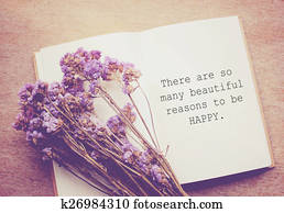 Inspirational motivating quote on notebook and flower with retro