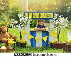 Boy Selling Yellow Lemonade at Stand