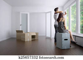 Empty Apartment with a Young Couple