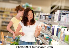 Shopping series - Brown hair woman in cosmetics department