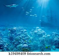 Sea or ocean underwater with shark and sunk treasures ship