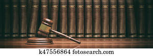 Wooden judge gavel and books. 3d illustration