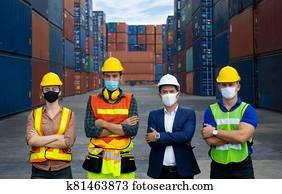Industrial workers or engineers wearing Coronavirus or COVID-19 protective masks