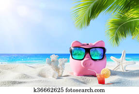 Piggy Bank With Drink On The Beach