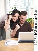 Happy couple online banking