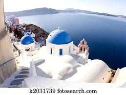 santorini greek island scene with blue dome churches