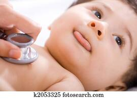 Baby checked by doctor