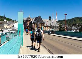 tourists cross the bridge at TrabenTrarbach during summer vacation
