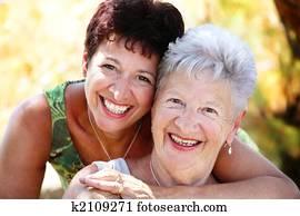 Beautiful senior mother and daughter smiling