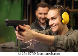 The woman at the shooting range.