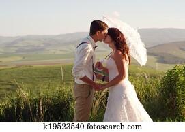 African bride and groom landscape