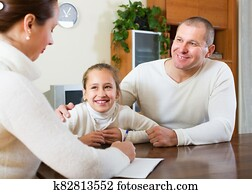 Family talking with employee