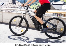 Man Riding E Bike Bicycle In City