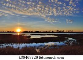 Sunset Over a Marsh and Pond