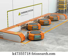 Warehouse robots charging at charging station