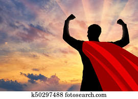 Silhouette of confident and strong businessman superman