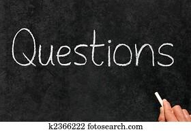 Questions written on a blackboard.