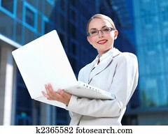 Title Caption Beautiful business woman standing outdoor modern building Keywords associate, attractive, beautiful, beauty, blue, building, business, businesswoman, career, caucasian, ceo, city, computer, confident, consultant, corporate, cute, executive,