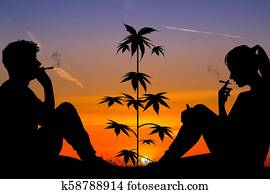 couple smoking marijuana outdoors