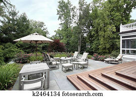 Slate patio with wooden stairs