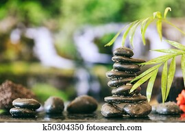 Zen stones stack on abstract background