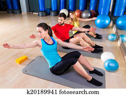 Pilates people group exercise man and women