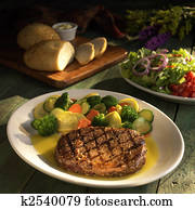 Steak with vegetables and salad