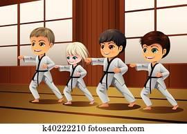 Kids Practicing Martial Arts in the Dojo