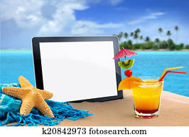 tablet in tropical beach